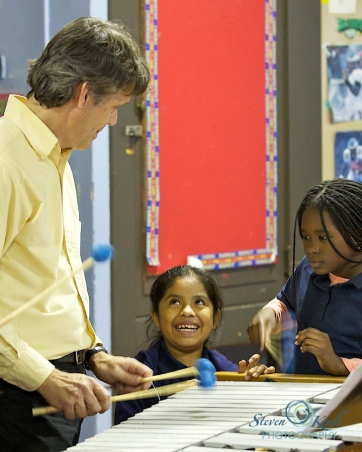 Relache's Chris Hanning with two students of United Communities Southeast Philadelphia's after school program